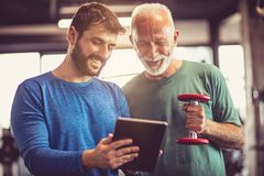 Good results. People at gym. royalty free stock photo