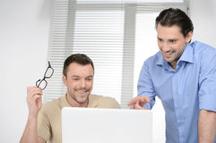 Good results! Two cheerful business people discussing something Stock Image