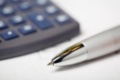 Good Sales Report. Close up of a calculator, financial figures and pen Royalty Free Stock Photos