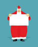 Good Santa Claus holding blank sign with space for text. Royalty Free Stock Photos