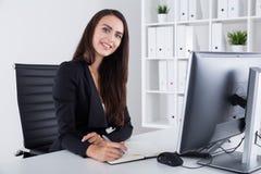Good secretary with long dark hair Royalty Free Stock Photo