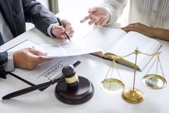 Good service cooperation, Consultation of Businesswoman and Male lawyer or judge counselor having team meeting with client, Law royalty free stock photos