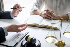 Good service cooperation, Consultation of Businesswoman and Male lawyer or judge counselor having team meeting with client, Law stock images