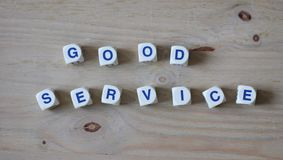 Good service. Letters cube wordings on wood background Royalty Free Stock Photo