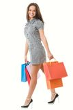 Good shopping day. Beautiful young woman with full shopping bags Stock Images