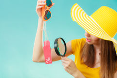 Woman choosing glasses searching through magnifying glass Royalty Free Stock Photos