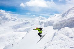 Good skiing in the snowy mountains. royalty free stock images