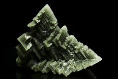 Good specimen of unusual green skeletal halite crystal. From Sieroszowice mine in Poland. Color is caused by the presence of rare tolbachite royalty free stock photos