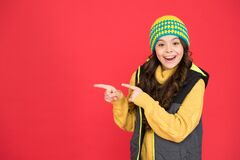 Free Good Stuff That. Happy Girl Pointing Index Fingers Red Background. Small Child In Winter Style Pointing At Something Stock Photo - 169809050