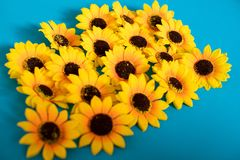Artificial sunflowers on blue background stock photos