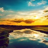 Good sunset over river Stock Photography