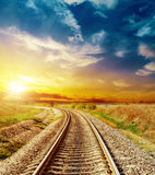 Good sunset sky over railroad. Good sunset in colored sky over railroad Royalty Free Stock Photography