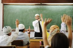 Good teacher in classroom stock images