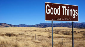 Good Things Just Ahead brown road sign Stock Images