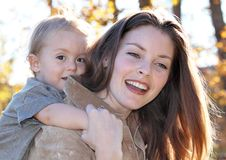 Good time. Women and baby walking in nature during fall Stock Images