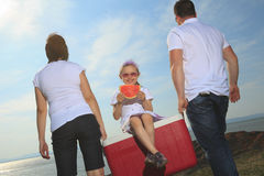 Good time family in front of ocean Stock Photography