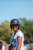 Good times during the game. Smiling Filipino softball player in white uniform royalty free stock photo
