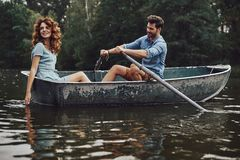 Good times. Beautiful young couple enjoying romantic date while rowing a boat stock photos