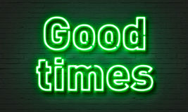 Good times neon sign on brick wall background. Royalty Free Stock Photos
