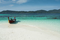 PASSENGER BOAT. White sand and blue sea with ferry from thailand Royalty Free Stock Photo