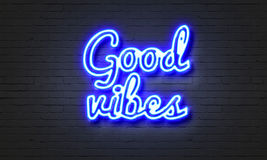 Good vibes neon sign on brick wall background. Royalty Free Stock Images