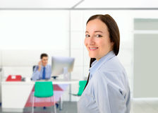 Good vibes in the office. Portrait of profile of businesswoman standing and looking back with her colleague on the background Stock Photography