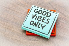 Good vibes only reminder note. Good vibes only reminder - handwriting on a sticky note against grained wood Stock Image