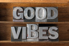 Good vibes tray. Good vibes phrase made from metallic letterpress type on wooden tray Royalty Free Stock Image