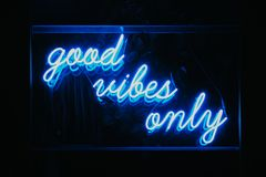 Good vibes only words in neon light signage. Good vibes only words in blue neon light signage stock images