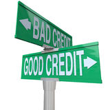 Good vs Bad Credit - Two-Way Street Sign. A green two-way street sign pointing to Good Credit and Bad Credit Royalty Free Stock Photo