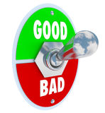 Good Vs Bad Words Toggle Switch Lever Judge Positive or Negative. The words Good and Evil on a toggle switch lever to decide or judge whether something is Stock Image