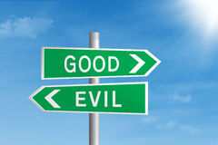 Good vs evil road sign royalty free stock photos