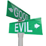 Good Vs Evil - Two-Way Street Sign Stock Images
