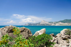 Good weather at the sea. Rocks, clouds, blue sky. Royalty Free Stock Images