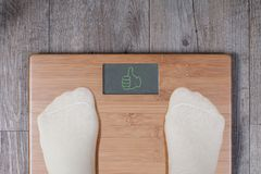Good weight – thumb up gesture stock photography