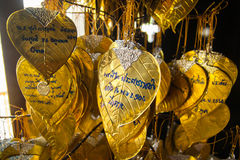 Good willing writing on the golden wish leaves. Thai people writes their wishes on the golden wish leaves Stock Photos