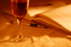 Good wine, books and pen Stock Image