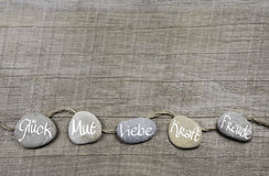 Free Good Wishes Wooden Background With Stones And German Text For Lu Stock Images - 46977624