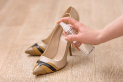 Good woman taking care of her shoes Royalty Free Stock Photo