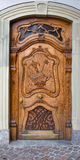 Good work. Richly decorated antique wooden door Royalty Free Stock Images