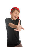 Good work thumbs up approval. A boy giving the thumbs up hand sign, (focus to hand) a popular western  gesture of approval, consent to go ahead, praise or Royalty Free Stock Photos