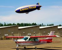 Good year blimp. The Good year blimp floats overhead coving the U.S. Open at Chambers Bay Washington Stock Photo