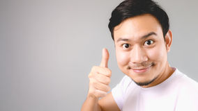 Good for you, face and thumb up sign. Stock Photo
