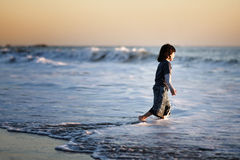 Goodbye. A child running at the beach in summer Royalty Free Stock Images
