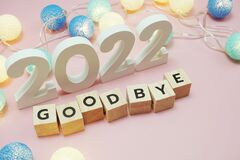 Goodbye 2022 alphabet letters with space copy on pink background