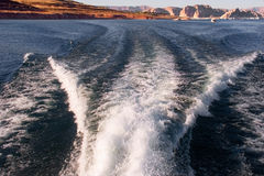 Goodbye coast. Foamy trace of a launch in Powell Lake stock image