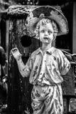 Goodbye eerie statue. Eerie statue boy garden waving black white Royalty Free Stock Photography