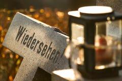 Goodbye-epigraph on a broken tombstone. Vienna main-cemetery Royalty Free Stock Photos