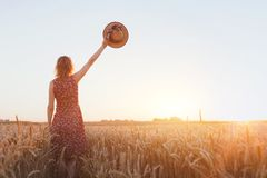 Goodbye or parting background, farewell. Woman waving hand in the field Royalty Free Stock Photos