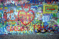 Goodbye Prague!. Graffiti on the wall of John Lennon in Prague - picture of red hearts and red Goodbye Prague Stock Image
